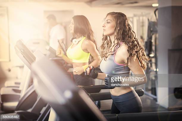 Young girls running on a treadmill at the gym