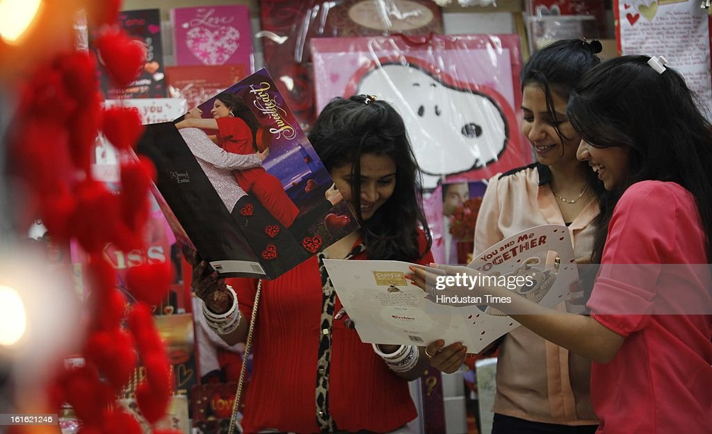 Young Girls selecting a valentine card for upcoming valentine day at souvenir shop on February 13, 2013 in Mumbai, India.