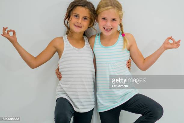 Young Girls Standing in Tree Pose
