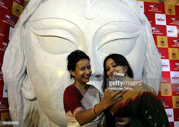 Young girls taking selfie in front of the world's largest Durga idol to be installed at Deshapriya Park during a press conference on August 20 2015...