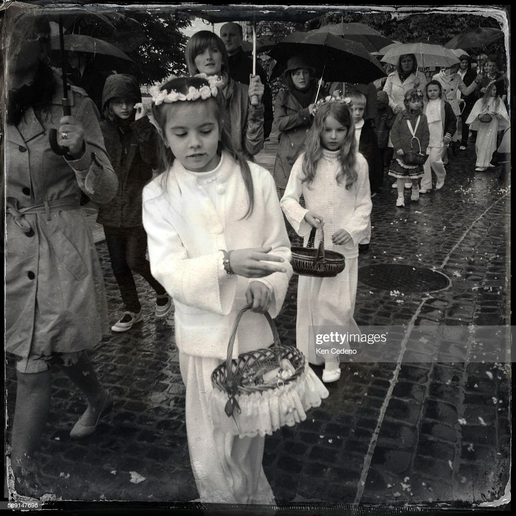 Young girls throw flower petals on the ground during a procession following church services at Wawel Cathedral in Krakow Poland celebrating The Feast...