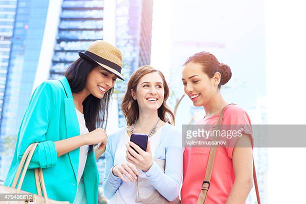Young girls using mobile phone in Dubai