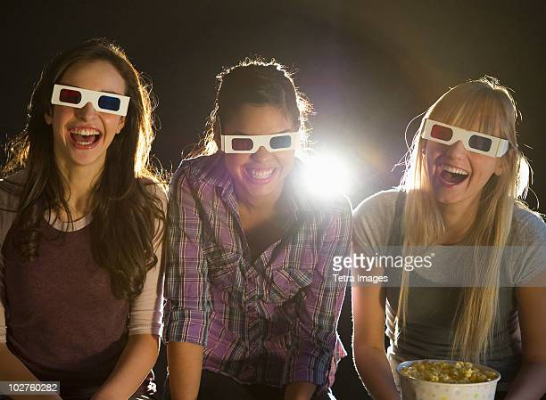 Young girls watching 3D movie