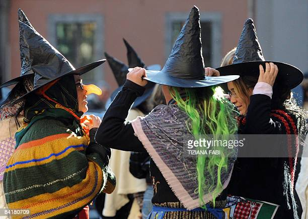 Young girls wearing Befana outfits take part in the annual Befana parade in Viterbo on January 5 the day before Epiphany A 52 meter long stocking is...
