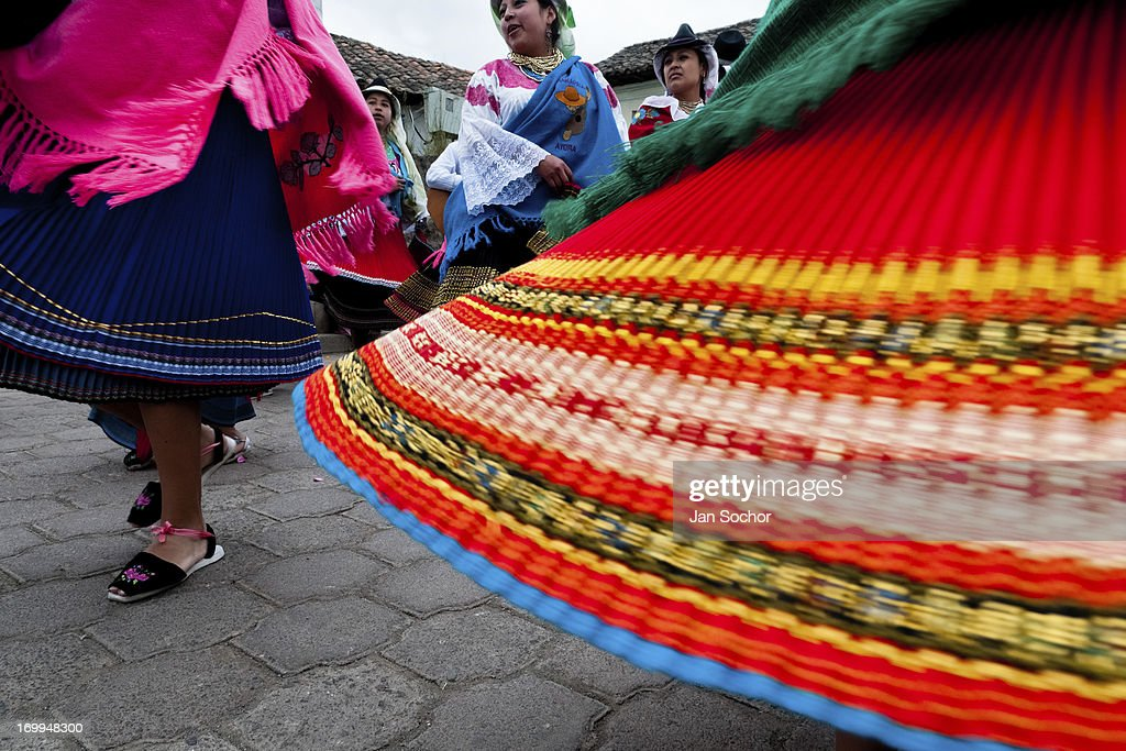 "Young girls, wearing colorful skirts, dance in a procession during the Inti Raymi fiesta on 26 June 2010 in the village of Olmedo, Ecuador. Inti Raymi, ""Festival of the Sun"" in Quechua language, is an ancient spiritual ceremony held in the Indian regions of the Andes, mainly in Ecuador and Peru. The lively celebration, set by the winter solstice, goes on for various days. The highland Indians, wearing beautiful costumes, dance, drink and sing with no rest. Colorful processions in honor of the God Inti (Sun) pass through the mountain villages giving thanks for the harvest and expressing their deep relation to the Mother Earth (Pachamama)."