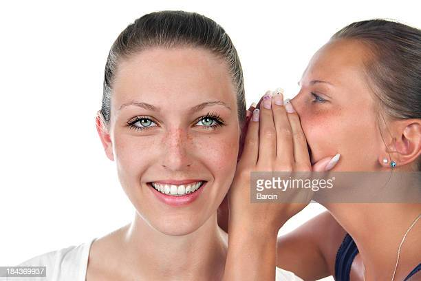 Young girls whispering