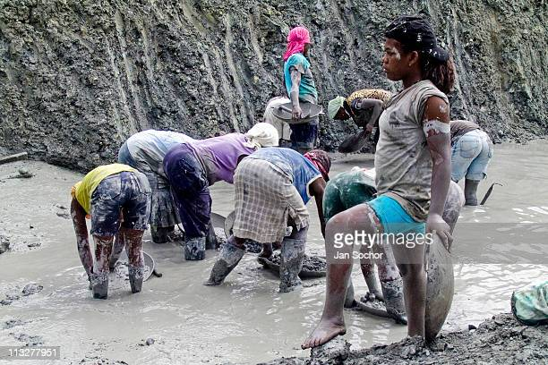 A young girls works barefoot in the mine near Tadó on May 26 2004 in Chocó This place where many women work illegally for a living is known as a no...