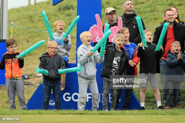 Young Golf fans show their support on the 1st hole during day one of GolfSixes at The Centurion Club on May 6 2017 in St Albans England