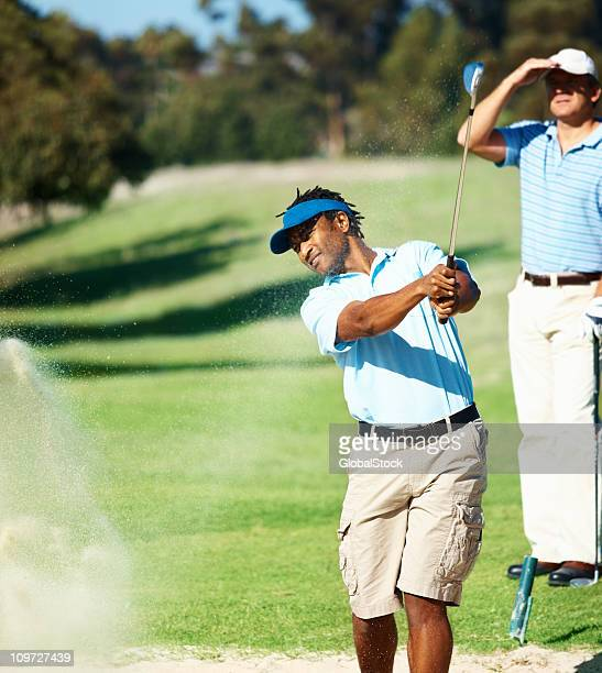 Young golfer during a stroke