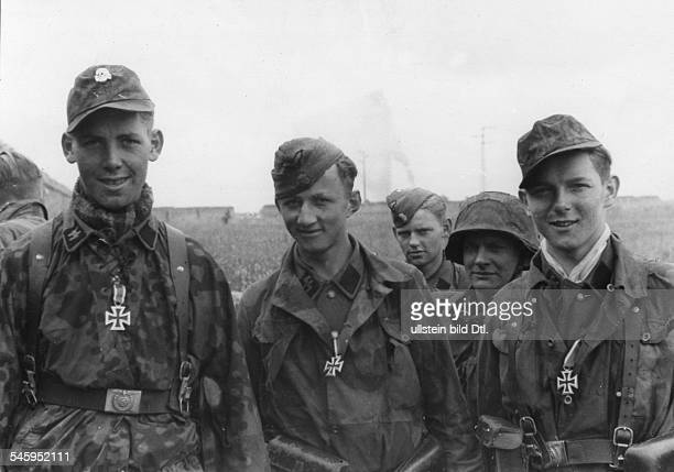 Young grenadiers of the 12th SS tank division HitlerJugend who excelled in the Battle for Caen were bestowed an 'Eisernes Kreuz'