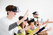 Young group having fun with new technology vr headset