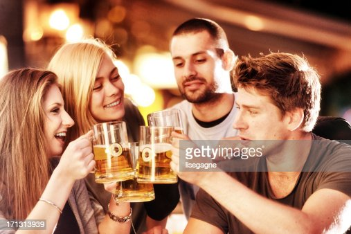 Young group of people having fun on a sidewalk bar