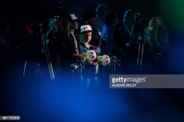 Young guests attend the arrival of the panda cubs Xing Ya and Wu Wen at Schiphol airport in Amsterdam on April 12 2017 after landing from China The...