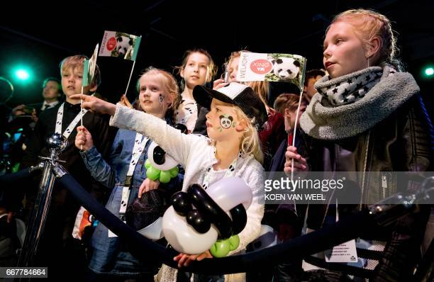 Young guests watch a livestream screening of the arrival of giant pandas Wu Wen and Xing Ya from China at Schiphol airport near Amsterdam on April 12...
