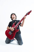 Young Guitar Player on White Background