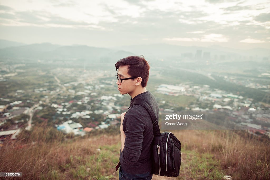 A young guy is on the mountain : Stock Photo