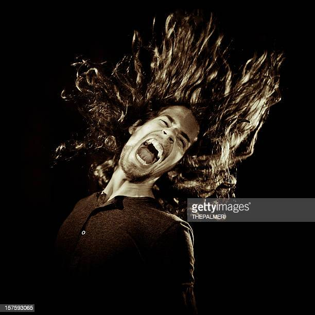 young guy screaming in the dark