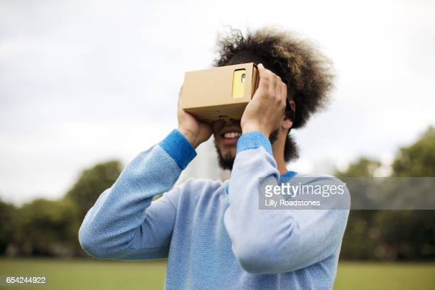 Young guy using virtual reality