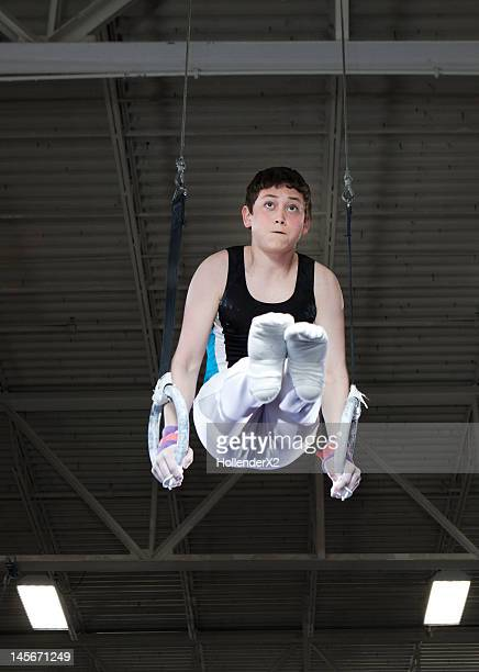 young gymnast on still rings