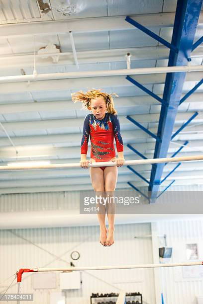 Young Gymnast on the Uneven Bars