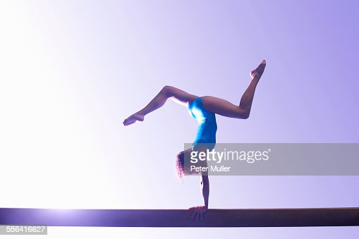 Young gymnast performing on balance beam