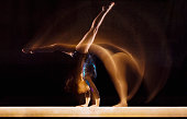 Gymnast Doing Cartwheel on Balance Beam
