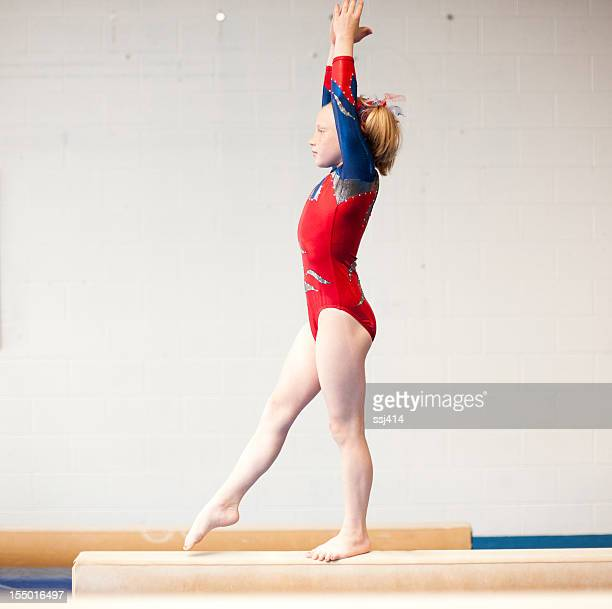 Young Gymnast Practicing Beam Routine