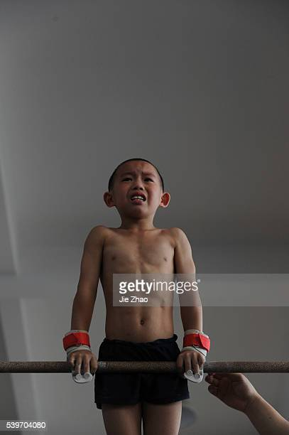 A young gymnast takes part in a training session for four to sevenyearolds at the gymnastics hall of a sports school in Jiaxing Zhejiang province...