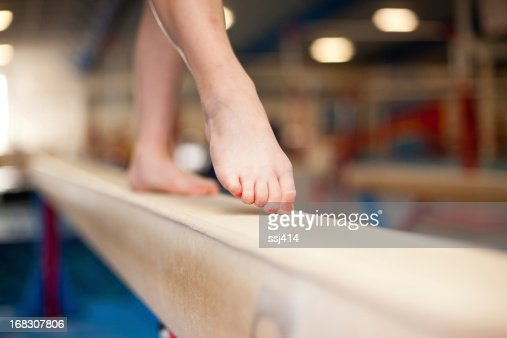 Young Gymnast Toes on Balance Beam