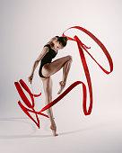 Flexible female doing acrobatic exercises