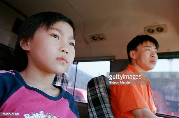 Young gymnast Zhao Chaoyue drives home with her father Zhao Chunqiang for a weekend visit to her family who live in a small tworoomed apartment on...