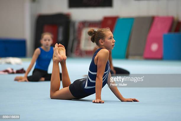 Young gymnasts practising moves