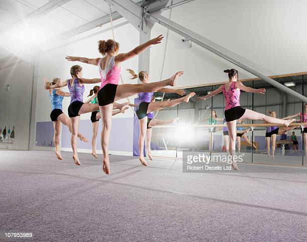 Young gymnasts rehearsing routine