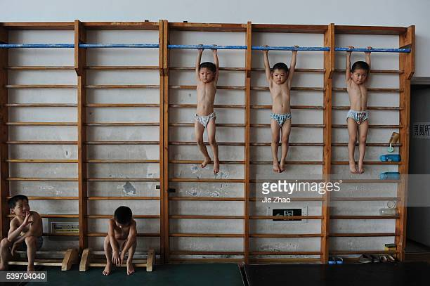 Young gymnasts take part in a training session for four to sevenyearolds at the gymnastics hall of a sports school in Jiaxing Zhejiang province...