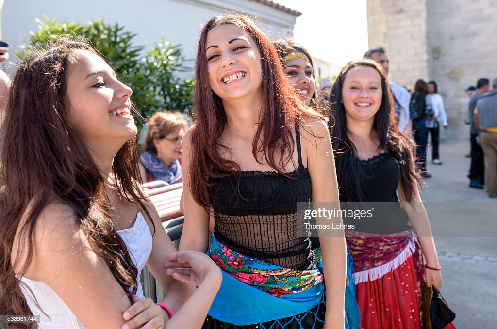 Young gypsies of the Romanies from Bratislava (Slovakia) pictured in front of church on May 24, 2016 in Staintes Maries de la Mere near Arles, France. Gypsies from all over Europe worship 'Sara the Black', their Saint and patroness, for one week. Sara's statue is situated in the crypt of the church. She wears a multicoloured dress and will carried by the gypsies to the sea at this afternoon.