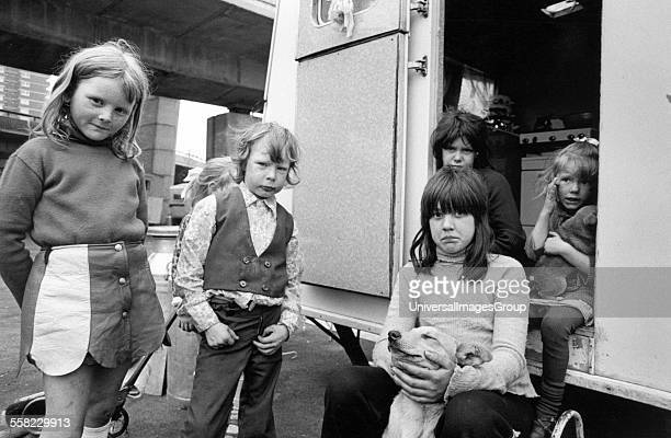 Young gypsy kids and a puppy in their caravan under the Westway motorway west London May 1973