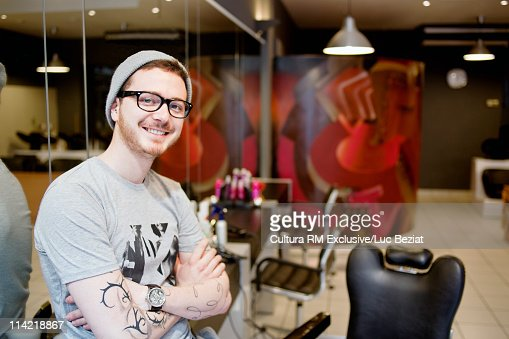 Young hairdresser in his salon : Stock Photo