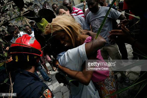 Young Haitian sisters Roxanne and Mwinda are reunited with their mother Flore following their extraction from the ruins of their home by French...