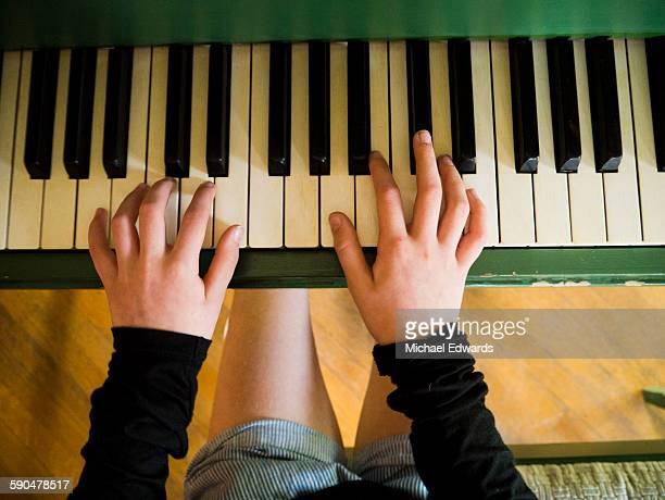 young hands on piano