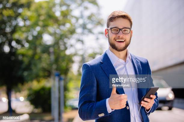 Young handsome businessman outdoors