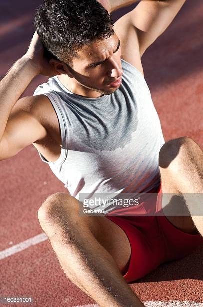 young handsome man doing exercise