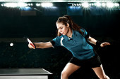 Portrait Of Young Woman Playing Table Tennis