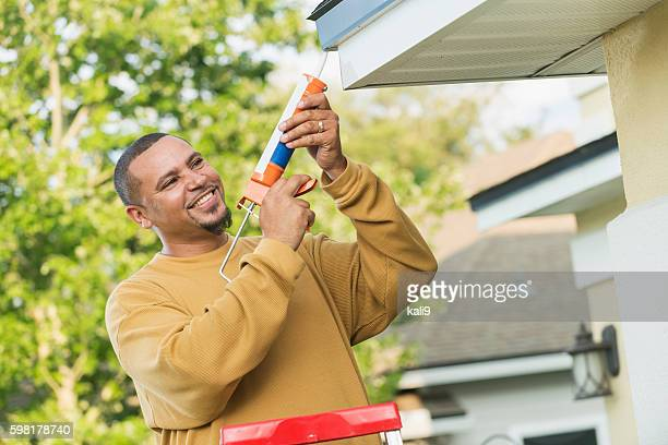 Young handyman doing house repairs