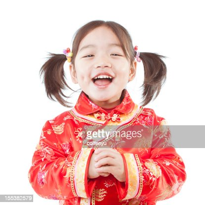 Young happy Chinese girl dressed for Spring Festival