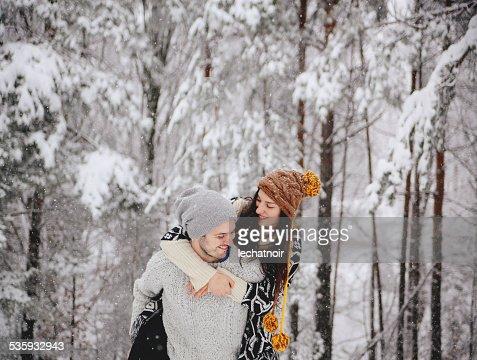Young happy couple enjoying winter holidays : Stock Photo