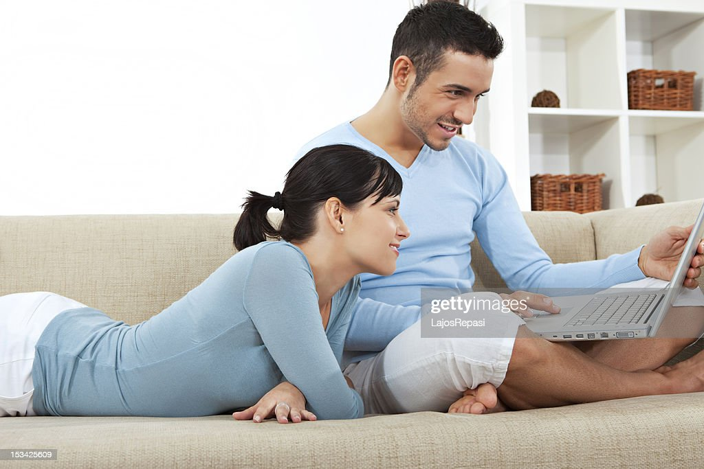 Young happy couple in the living room : Stock Photo