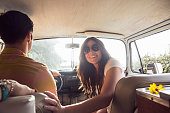 Young happy couple on camper van road trip