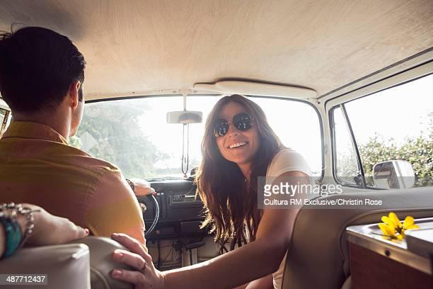 Young happy couple on camper van road trip