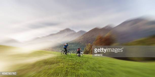 Young Happy Couple Riding Bicycles  in nature