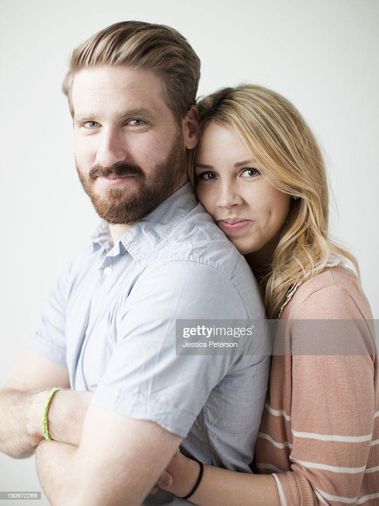 Young happy couple, studio shot : Stock Photo